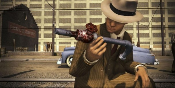 Detective Cole, of L.A. Noire, holding a bloodied metal pipe. Demonstrating the point-and-click elements of the game.